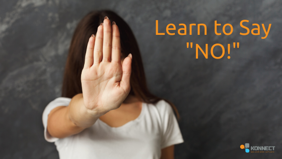 "A hand in front of a face signifying ""NO""."